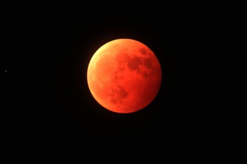 Photo by Imaginechina/REX (4181801b) Blood moon above Qingdao city, Shandong province 'Blood Moon'total lunar eclipse, China - 08 Oct 2014