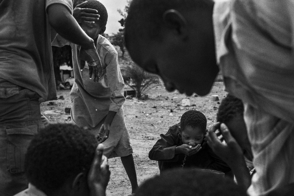 Children that used to be talibes cool off at SOS Talibe Center in Bafata, Guinea-Bissau, June 8, 2015. The Center received 45 cases of talibes returning from Senegal in 2014, some of them ran away from the daaras but others were handed over by the marabouts to the authorities when some of them were brought to the courts.